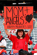 ANAHEIM, CA - MAY 08:  A young fan of the Los Angeles Angels of Anaheim holds up a sign in honor of Mother's Day during the game between the Cleveland Indians and the Los Angeles Angels of Anaheim on Sunday, May 8, 2011 at Angel Stadium in Anaheim, California. The Angels won the game 6-5. (Photo by Paul Spinelli/MLB Photos via Getty Images)