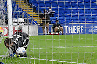 Football - 2019 / 2020 Championship - Play-off semi-final - 1st leg - Cardiff City vs Fulham<br /> <br /> Alexander Smithies of Cardiff City is beaten by a free kick from Neeskens Kebano of Fulham in extra time						<br /> in a match played with no crowd due to Covid 19 coronavirus emergency regulations, in an almost empty ground, at the Cardiff City Stadium<br /> <br /> COLORSPORT/WINSTON BYNORTH