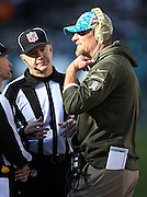 Miami Dolphins head coach Dan Campbell talks on the sideline to two officials during the 2015 week 10 regular season NFL football game against the Philadelphia Eagles on Sunday, Nov. 15, 2015 in Philadelphia. The Dolphins won the game 20-19. (©Paul Anthony Spinelli)