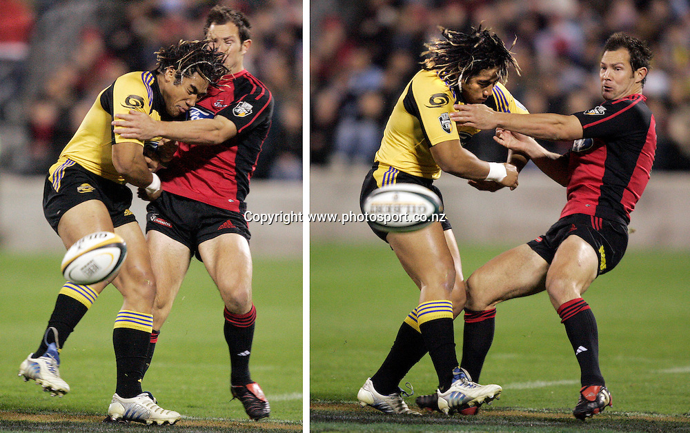 20/5/2005. Hurricanes Ma'a Nonu spills the ball in a heavy tackle with Crusaders fullback Leon McDonald during their Super 12 semi final clash at Jade Stadium in Christchurch on  Friday night. Photo: PHOTOSPORT