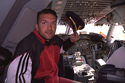 JOHANNESBURG, REPUBLIC OF SOUTH AFRICA - Wednesday, May 25, 1994: Liverpool's captain Neil Ruddock tries out the captain's hat in the cockpit as the team fly to Cape Town in South Africa during an end-of-season tour. (Pic by David Rawcliffe/Propaganda)