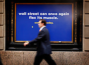 "Manhattan, New York, USA, 20110805: An ad on Wall Street for New York Sports Club states "" Wall Street can once again flex it's muscles. "" Stocks on Wall Street surge in the morning, reacting to the 117k jobs added in the last week.Photo> Orjan F. Ellingvag& Dagens Næringsliv"