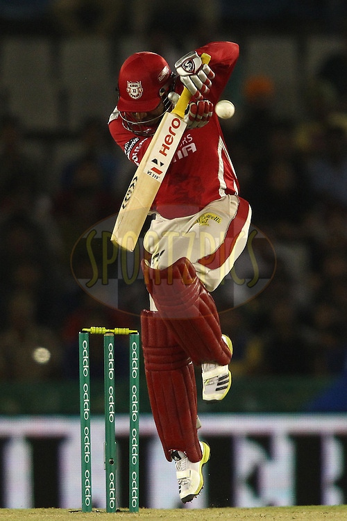 Virender Sehwag of the Kings XI Punjab defends a short delivery during match 5 of the Oppo Champions League Twenty20 between the Kings XI Punjab and the Barbados Tridents held at the Punjab Cricket Association Stadium, Mohali, India on the 20th September 2014<br /> <br /> Photo by:  Shaun Roy / Sportzpics/ CLT20<br /> <br /> <br /> Image use is subject to the terms and conditions as laid out by the BCCI/ CLT20.  The terms and conditions can be downloaded here:<br /> <br /> http://sportzpics.photoshelter.com/gallery/CLT20-Image-Terms-and-Conditions-2014/G0000IfNJn535VPU/C0000QhhKadWcjYs
