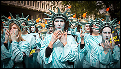 April 27, 2017 - London, United Kingdom - Amnesty Protest 100 Days of Trump. One hundred human rights activists from Amnesty International dressed as the Statue of Liberty protest outside the US Embassy in London's Grosvenor Square. The protest is set to mark 100 days of Trump's presidency of the United States of America. (Credit Image: © Pete Maclaine/i-Images via ZUMA Press)