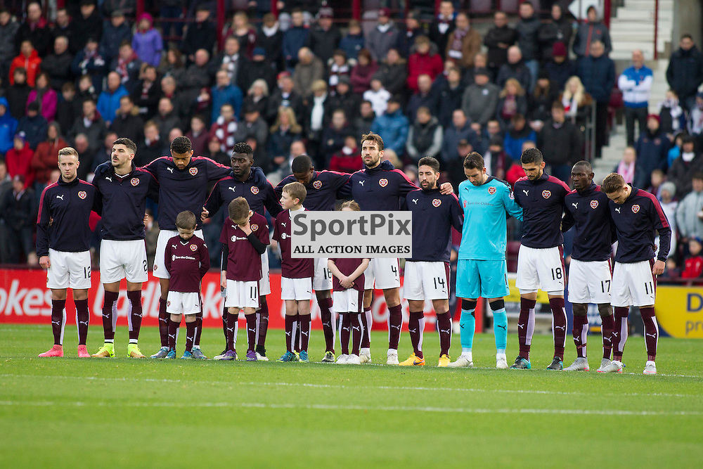 Teams take a minute silence in respect of the recent terrorist attacks during the Ladbrokes Scottish Premiership match between Heart of Midlothian FC and Dundee FC at Tynecastle Stadium on November 21, 2015 in Edinburgh, Scotland. Photo by Jonathan Faulds/SportPix