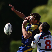 Paul Grant, Otago, (left) is tackled by Nathan Hughes, Auckland, during the Pub Charity Rugby Sevens 2012 New Zealand tournament at the Queenstown Recreation Ground, Queenstown, Otago, New Zealand. 8th January 2012. Photo Tim Clayton