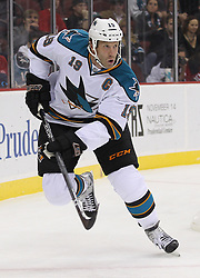 Oct 21; Newark, NJ, USA; San Jose Sharks center Joe Thornton (19) skates during the first period of their game against the New Jersey Devils at the Prudential Center.