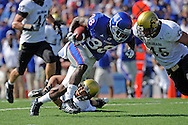 Oct 11, 2008; Lawrence, KS, USA; Kansas Jayhawks wide receiver Dexton Fields (88) heads up field after making a catch against pressure from Colorado Buffaloes safety Anthony Perkins (46) during the second quarter at Memorial Stadium.  Kansas won 30-14.
