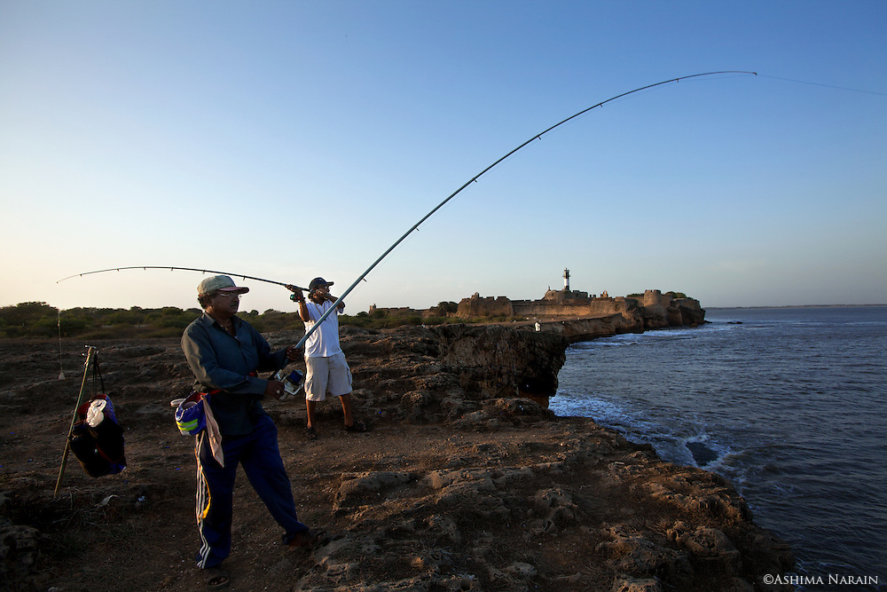 Champak Lamba and Virchand Kanaji Barya come to fish by Diu Fort when they visit their families in Diu. Both of them have been in the Merchant Navy for over 20 years. Now, Mr. Lamba sings professionally at Gujarati weddings and religious festivals. <br />