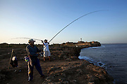 Champak Lamba and Virchand Kanaji Barya come to fish by Diu Fort when they visit their families in Diu. Both of them have been in the Merchant Navy for over 20 years. Now, Mr. Lamba sings professionally at Gujarati weddings and religious festivals. <br /> In 1535 the Portuguese built the Diu Fort, as part of a defense alliance with Bahadur Shah, the Sultan of Gujarat, against the Mughal Emperor Humayun. Today it attracts hundreds of tourists daily, many of whom like to pose on its ramparts.