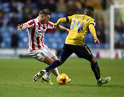 Cheltenham Town's Lee Vaughan gets the ball past Oxford United's Tareiq Holmes-Dennis - Photo mandatory by-line: Paul Knight/JMP - Mobile: 07966 386802 - 03/01/2015 - SPORT - Football - Oxford - Kassam Stadium - Oxford United v Cheltenham Town - Sky Bet League Two