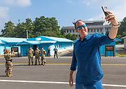 THE BOTH SIDES OF THE DMZ<br /> <br /> I first visited the Demilitarized Zone on the North Korean side in 2008. The DMZ is a 250 km long, 4km wide stretch of land that serves as a buffer zone between North and South Korea.<br /> I came back 5 times there before being banned by the North Korean regim.<br /> I visited the DMZ on the South Korean side twice in 2016 and 2017.<br /> The both sides have huge differences but not in the way you may expect sometimes...<br /> The two Koreas have signed armistice but not peace. The Joint Security Area in Panmunjom is called a « demilitarized zone », but in fact it is the most armed zone in the world and also a major touristic attraction both in North and South with more than 100 000 tourists coming there every year.<br /> <br /> Photo shows:  In South Korea, the american and south korean soldiers won't allow you to do it. But they do it for themselves as you can see in the back!<br /> ©Eric Lafforgue/Exclusivepix Media