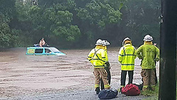 EXCLUSIVE: Pic shows Australian emergency services before they rescued three UK tourists stranded on top of their camper van. Three British backpackers had to be rescued when they woke up in their camper van to find they were surrounded by croc infested floodwater. The unhappy campers called emergency crews around 6am (local time) today (TUES) when they became flooded at Green Patch, a camping ground south of Cairns, Queensland, Australia. Officers from Queensland Fire and Emergency Services (QFES) arrived at the campsite to find three tourists – two male and one female - from the UK cowering on the roof of the Scooby-Doo-like coloured hire vehicle. It's understood the Brits feared the water could be hiding man eating saltwater crocodiles which are common in Queensland and can grow up to 16-foot long. Nearby signs indicated that the area was a crocodile warning area and locals said there were resident reptiles in the murky water. (see Magnus copy) pictures@magnusnewsagency.com +44(0)1214584402. 06 Feb 2018 Pictured: Pic from Magnus News Agency. Pic shows Australian emergency services before they rescued three UK tourists stranded on top of their camper van. Three British backpackers had to be rescued when they woke up in their camper van to find they were surrounded by croc infested floodwater. The unhappy campers called emergency crews around 6am (local time) today (TUES) when they became flooded at Green Patch, a camping ground south of Cairns, Queensland, Australia. Officers from Queensland Fire and Emergency Services (QFES) arrived at the campsite to find three tourists – two male and one female - from the UK cowering on the roof of the Scooby-Doo-like coloured hire vehicle. It's understood the Brits feared the water could be hiding man eating saltwater crocodiles which are common in Queensland and can grow up to 16-foot long. Nearby signs indicated that the area was a crocodile warning area and locals said there were resident reptiles in the murky water
