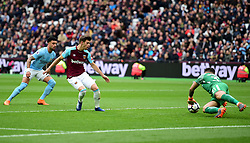Ederson of Manchester City makes a save from Manuel Lanzini of West Ham United shot.  - Mandatory by-line: Alex James/JMP - 29/04/2018 - FOOTBALL - London Stadium - London, England - West Ham United v Manchester City - Premier League