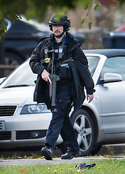 © Licensed to London News Pictures. 22/10/2016. London, UK. An armed policeman is seen in Northolt. Police attended an address in Wood End Lane, Northolt at shortly after 00:50hrs on Friday, 21 October after a report of concerns for the occupant and hazardous items inside the property. Police believe a man is still inside the house. Photo credit: Ben Cawthra/LNP