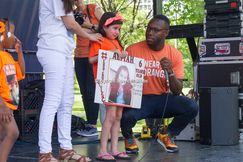 """Organizations pushing to get rid of gun violence came together Saturday afternoon, June 5th, 2017 for the Party for Peace, an event designed to raise awareness about issues related to gun violence by using live music and education. This event was held in Washington Park located at 51st and Hyde park Blvd and was sponsored by the organization Everytown for Gun Safety.<br /> <br /> 7030 – Event organizers console Caitlin Aguilar as she breaks down while talking about her six year old sister who was gunned down in 2012.<br /> <br /> Please 'Like' """"Spencer Bibbs Photography"""" on Facebook.<br /> <br /> All rights to this photo are owned by Spencer Bibbs of Spencer Bibbs Photography and may only be used in any way shape or form, whole or in part with written permission by the owner of the photo, Spencer Bibbs.<br /> <br /> For all of your photography needs, please contact Spencer Bibbs at 773-895-4744. I can also be reached in the following ways:<br /> <br /> Website – www.spbdigitalconcepts.photoshelter.com<br /> <br /> Text - Text """"Spencer Bibbs"""" to 72727<br /> <br /> Email – spencerbibbsphotography@yahoo.com"""