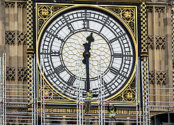 © Licensed to London News Pictures. 10/10/2017. Workers erect 96 meters of scaffolding up to the clock face of The Elizabeth Tower - home of the Big Ben bell at The Houses of Parliament.  The work is part of a three-year programme to conserve the Great Clock, the tower and Big Ben. London, UK. Photo credit: Peter Macdiarmid/LNP
