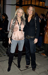 Left to right, HANNAH SANDLING and EMILY CROMPTON at a party to launch a new stor for tailors Pogson & Davis in Davies Street, London W1 on 15th December 2005.<br />