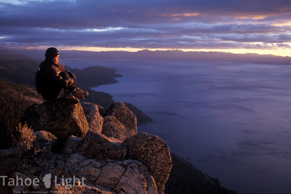 Monique Sady watches a stormy sunset above Lake Tahoe from the Sand Harbor overlook along the Tahoe Rim Trail.