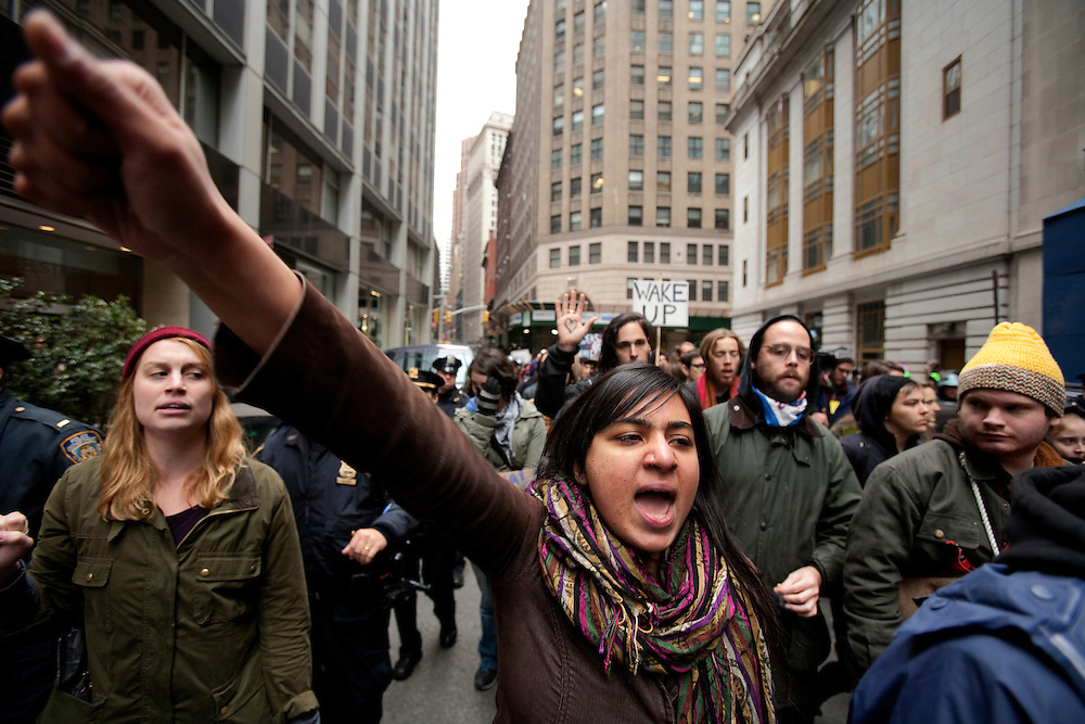 Occupy Wall Street protesters and police struggle during a demonstration against economy un justice and wall street companies. About a block from the New York Stock Exchange November 17, 2011 in New York.
