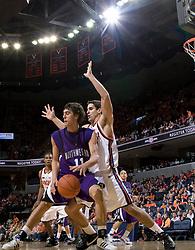 Northwestern forward-center Nikola Baran (11) is guarded by Virginia forward/center Ryan Pettinella (34).  The Virginia Cavaliers men's basketball team defeated the Northwestern Wildcats 94-52 at John Paul Jones Arena in Charlottesville, VA on November 27, 2007.