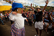 People dance with the mascot Miss Coffee Beans during the Maricao Coffee Festivals in the highlands of Puerto Rico