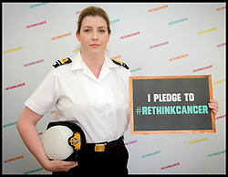Image ©Licensed to i-Images Picture Agency. 25/06/2014. London, United Kingdom. Coppafeel founder Kris Hallenga launches her RethinkCancer Manifesto in the House of Commons. MP Penny Mordaunt in her Navy uniform holds one of Kris's pledges Picture by Andrew Parsons / i-Images