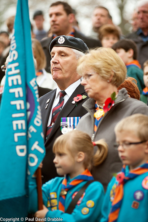 Veterans and young people stand sholder to sholder while taking part in the 2011 local Remembrance Day Parade in Chapeltown Sheffield South Yorkshire. According to many local people this years parade was especially well attended.13 November 2011. Image © Paul David Drabble