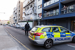 © Licensed to London News Pictures. 24/04/2017. LONDON, UK.  Police officers at the police cordon in Bow Common Lane in Mile End, east London, where a man in his 60's was stabbed to death last night.  Photo credit: Vickie Flores/LNP