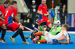 The Netherlands Constantijn Jonker battles for the ball with Marat Gafarov of Russia. Russia v The Netherlands - Unibet EuroHockey Championships, Lee Valley Hockey & Tennis Centre, London, UK on 25 August 2015. Photo: Simon Parker