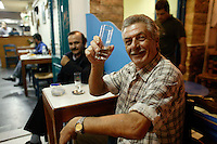 scenes in non touristic Naxos in the Cyclades Islands of Greece Men drinking and socializing
