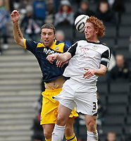 Photo: Steve Bond/Richard Lane Photography. MK Dons v Southampton. Coca-Cola Football League One. 20/03/2010. Rickie Lambert (L) loses out to Dean Lewington (R)