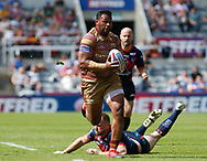 Danny Kirmond of Wakefield Trinity can't stop the run of Ukuma Ta&rsquo;ai of Huddersfield Giants during the Betfred Super League match at the Dacia Magic Weekend, St. James's Park, Newcastle<br /> Picture by Stephen Gaunt/Focus Images Ltd +447904 833202<br /> 20/05/2018