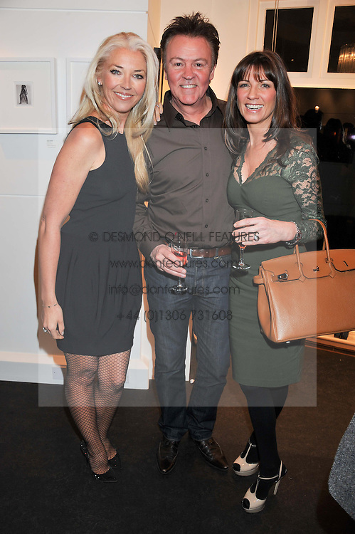 Left to right, TAMARA BECKWITH and PAUL & STACEY YOUNG at a Private View of Bruno Bisang 30 Years of Polaroids held at The Little Black Gallery, 13A Park Walk, London SW10 on 15th January 2013.