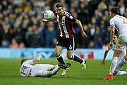 Sheffield United's Chris Basham goes past Eunan O'Kane of Leeds United during the EFL Sky Bet Championship match between Leeds United and Sheffield Utd at Elland Road, Leeds, England on 27 October 2017. Photo by Paul Thompson.