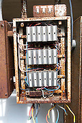 Old rusty electrical fuse box, UK