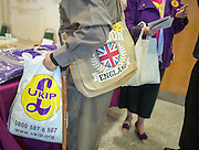 © Licensed to London News Pictures. 26/09/2014. Doncaster, UK. Delegates purchase UKIP products at a stall.  The UKIP conference at Doncaster Racecourse Friday 26th September 2014. Photo credit : Stephen Simpson/LNP