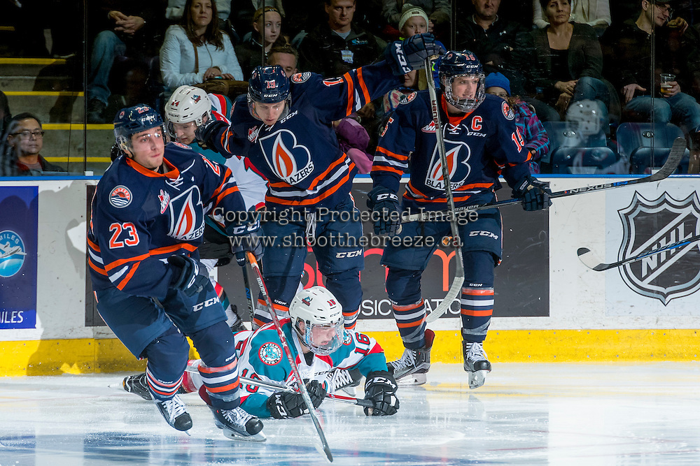 KELOWNA, CANADA - DECEMBER 27: Kole Lind #16 of the Kelowna Rockets is checked to the ice by Erik Miller #19 of the Kamloops Blazers on December 27, 2016 at Prospera Place in Kelowna, British Columbia, Canada.  (Photo by Marissa Baecker/Shoot the Breeze)  *** Local Caption ***