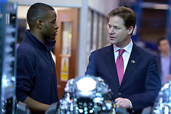 © Licensed to London News Pictures. 14/03/2013. London, UK Deputy Prime Minister Nick Clegg (right) talks to Jamal Peters (Left), an apprentice, whilst he services theatrical lighting at the company. Deputy Prime Minister Nick Clegg visits White Light, a company in South West London, to talk to apprentices and launch the Government's response to the Richard Review today 14th March 2013. Photo credit : Stephen Simpson/LNP