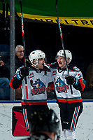 KELOWNA, BC - MARCH 6: Matthew Wedman #20 and Jonas Peterek #27 of the Kelowna Rockets celebrate a first period goal against the Seattle Thunderbirds at Prospera Place on March 6, 2020 in Kelowna, Canada. (Photo by Marissa Baecker/Shoot the Breeze)