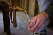 The first of a batch of Back River Gin coming out of a pot still at Sweetgrass Winery, Union, Maine.