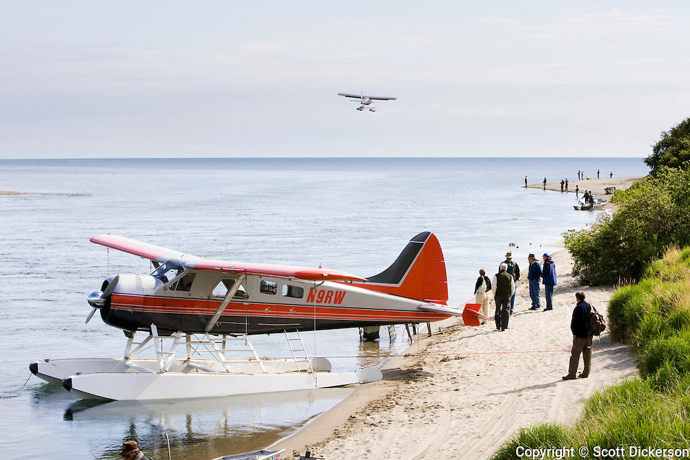 A sportfishing lodge's DeHavilland DHC-2 Beaver floatplane picks up and drops off guests coming to sportfishing lodges on the Kvichak River in Bristol Bay, Alaska.