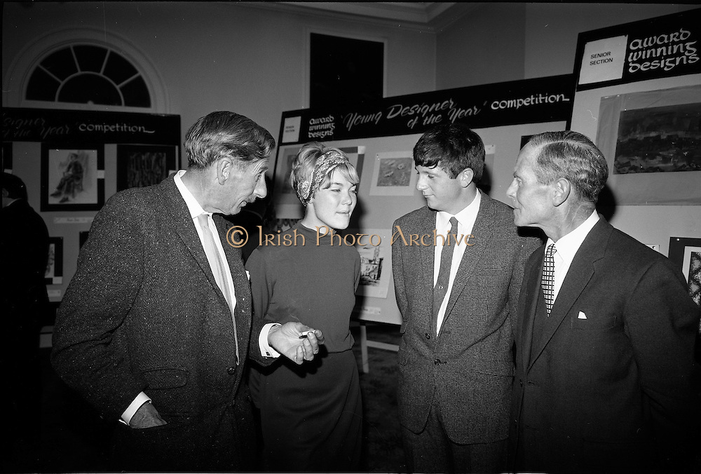 "28/06/1967<br /> 06/28/1967<br /> 28 June 1967<br /> Presentation of prizes at Navan Carpets ""Young Designer of the Year"" reception in the Royal Hibernian Hotel, Dublin. Image shows (l-r): Mr. Michael Bourke, Principal of the National College of Art; Miss Jan Bell, State of Oregon, USA; Mr. Brendan McKeon, (prize-winner) Castlerea, Co. Roscommon and Mr. B.V. Fox, Navan Carpets Ltd. at the reception."