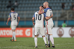 October 10, 2017 - Couva, Caroni County, Trinidad & Tobago - Couva, Trinidad & Tobago - Tuesday Oct. 10, 2017: Christian Pulisic scores a goal and celebrates with Michael Bradley during a 2018 FIFA World Cup Qualifier between the men's national teams of the United States (USA) and Trinidad & Tobago (TRI) at Ato Boldon Stadium. (Credit Image: © John Dorton/ISIPhotos via ZUMA Wire)