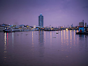 28 SEPTEMBER 2015 - BANGKOK, THAILAND: Boats on the Chao Phraya River in Bangkok at dawn.     PHOTO BY JACK KURTZ