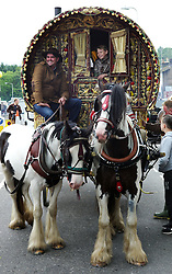 © Licensed to London News Pictures. <br /> 05/06/2014. <br /> <br /> Appleby, Cumbria, England<br /> <br /> Gypsies and travellers gather during the annual horse fair on 5 June, 2014 in Appleby, Cumbria. The event remains one of the largest and oldest events in Europe and gives the opportunity for travelling communities to meet friends, celebrate their music, folklore and to buy and sell horses.<br /> <br /> The event has existed under the protection of a charter granted by King James II in 1685 and it remains the most important event in the gypsy and traveller calendar.<br /> <br /> Photo credit : Ian Forsyth/LNP