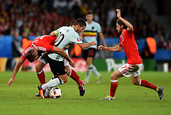 Joe Ledley of Wales tackles Eden Hazard of Belgium  - Mandatory by-line: Joe Meredith/JMP - 01/07/2016 - FOOTBALL - Stade Pierre Mauroy - Lille, France - Wales v Belgium - UEFA European Championship quarter final