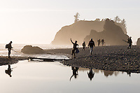 Hikers crossing a tidal creek to access Ruby Beach, Olympic National Park, Washington