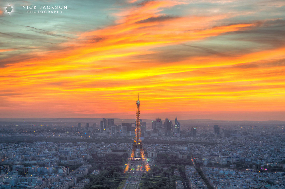 I visited Paris for just 2 days to experience F&ecirc;te de la Musique, a very popular annual music event where anyone is allowed to perform music on the street. <br /> <br /> However, I noticed that the sunset was going to be a good one that evening so quickly headed up to the top of Tour Montparnasse and positioned my tripod with the camera facing towards the Eiffel Tower. What followed was one of the best sunsets I've ever witnessed- fiery oranges and reds became deep purples as the sky darkened and night fell, with the backdrop of the tower lighting up.
