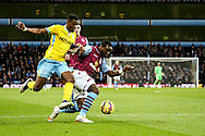 Christian Benteke of Aston Villa (right) defends from Wilfried Zaha of Crystal Palace (left) during the Barclays Premier League match at Villa Park, Birmingham<br /> Picture by Andy Kearns/Focus Images Ltd 0781 864 4264<br /> 01/01/2015
